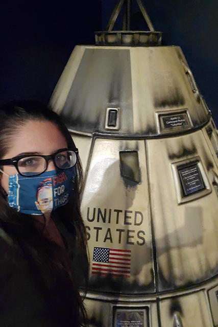 woman taking selfie with replica space capsule