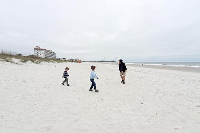 family running on section of Jacksonville Beach