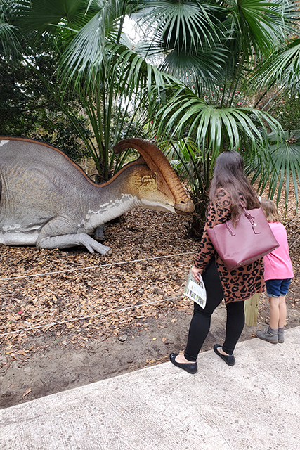 woman and little girl looking at dinosaur statue at Leu gardens during Dinosaur Invasion