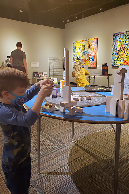 Little boy building tower with blocks at discovery station for kids at Jacksonville MOSH