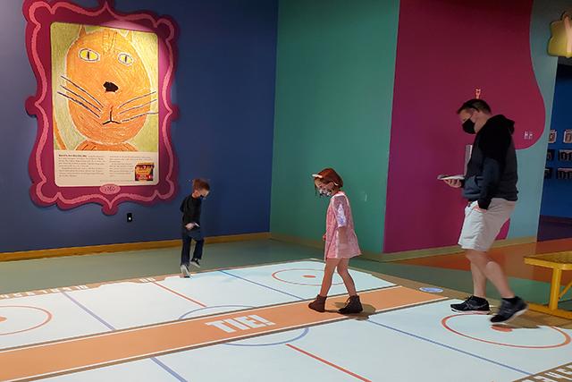 kids playing digital air hockey on floor