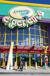 Family Standing in front of Crayola Experience in Orlando Florida
