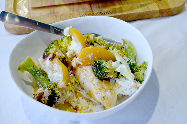 Chicken Broccoli Peach Bake served on rice in a white bowl