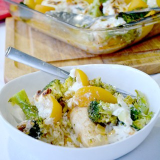 Chicken Broccoli Peach Bake in a white bowl in front of pan of the casserole