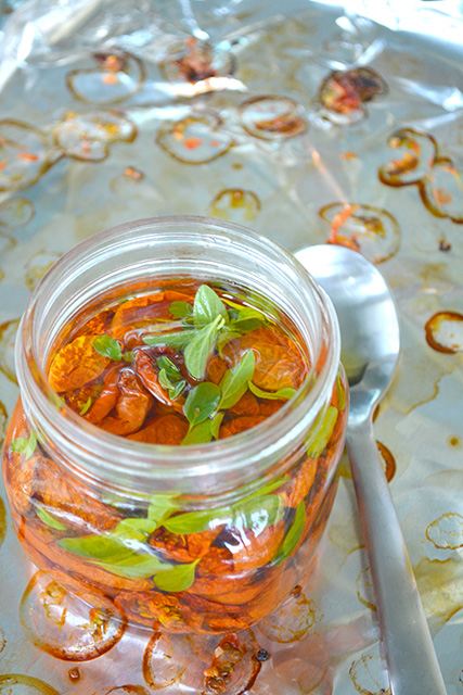 wide mouth jar filled with oil and slow roasted tomatoes