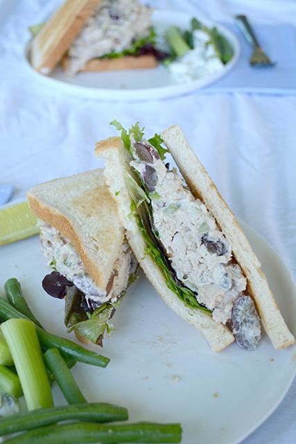 Chicken Salad Sandwich cut on a diagonal arranged on a white plate