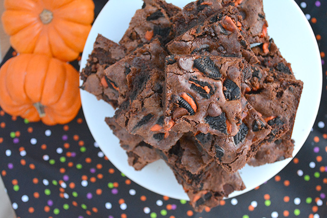 Brownies studded with Halloween themed Oreos on colorful napkins.