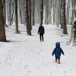 dad and son in hardwick park sedgefield in snow