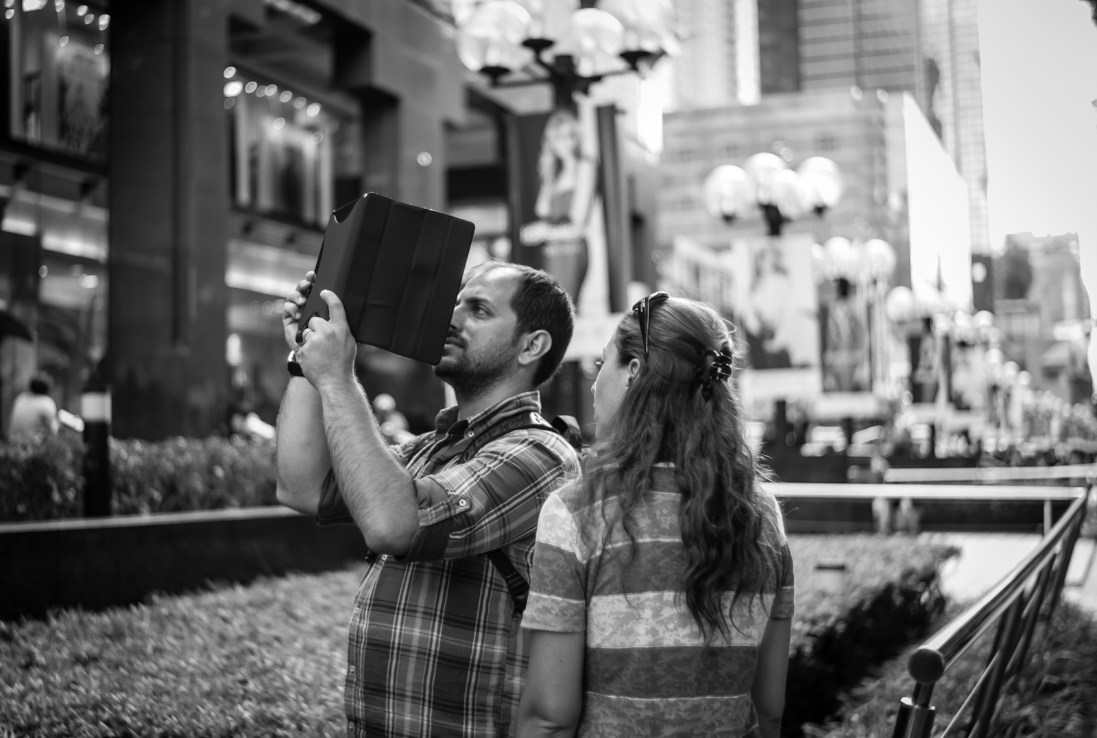 Tourist taking photos with his tablet