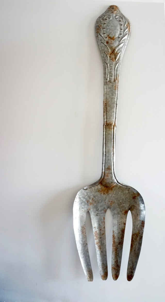 how to decorate with personality - giant fork - http://iamsherrelle.com