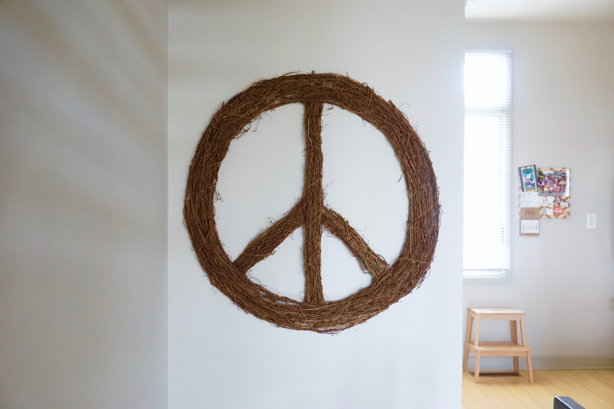 how to decorate with personality - CB2 peace wreath - http://iamsherrelle.com