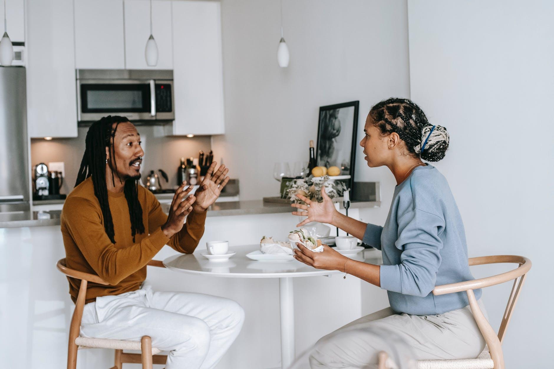 ethnic couple quarrelling in kitchen