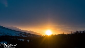 A brilliant winter sunset along the Dalton Highway, Alaska.