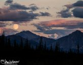 A supermoon rise fuses with the sunset south of Atigun Pass, Brooks Range, Alaska.