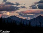 A supermoon rise fuses with the sunset south of Atigun Pass, Brooks Range, Alaska.