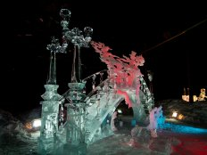 This sculpture over the bridge is cool in its contrast with the frosty men crossing it.