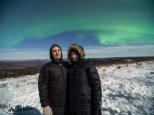 Pat and Tashina in front of a beautiful aurora