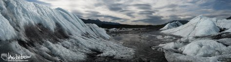This panoramic image looks back at the glacier, and down the headwaters of the Matanuska River.