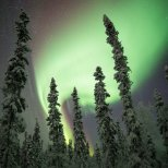 A powerful flare of aurora threatens to blow out this image. Such a beautiful scene!
