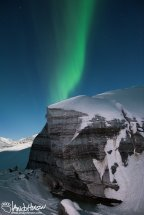 The Northern Lights Build over Castner Glacier.