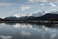 The Mountains shimmer off an open river as you come into Haines, Alaska