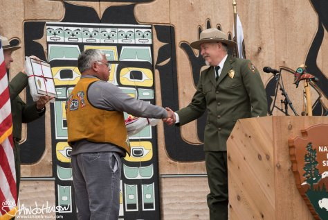 Phil Hodges and Frank Wright shake hands after receiving the NPS Directors award for collaboration.