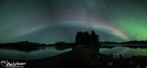 "The Aurora Borealis shows off a pale display in Hoonah, Alaska which is often identified a ""Proton Arc"""
