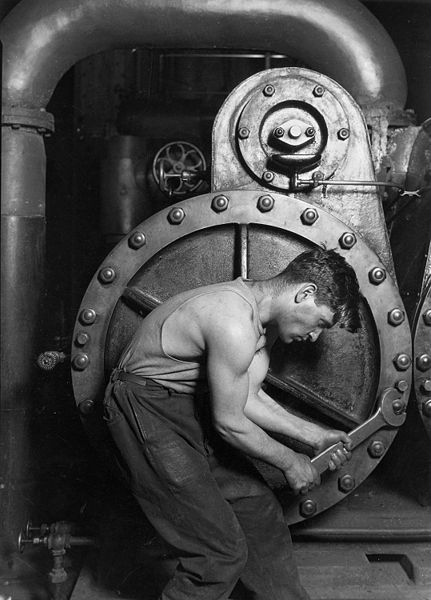 Lewis Hine, 1920. Power house mechanic working on steam pump. Records of the Work Progress Administration. (69-RH-4L-2)