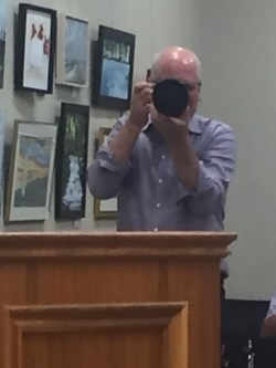 Seglins taking pictures of the mayor
