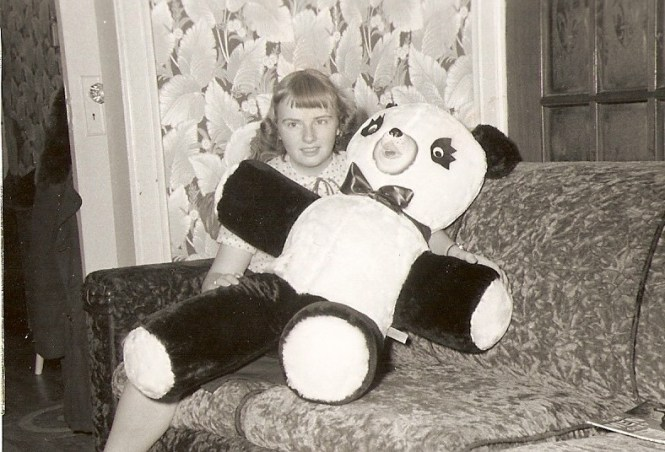 Carol Hadden with her stuffed panda bear, mid-1950s