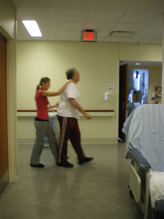 Yours Truly being taught how to walk again in the halls of the hospital with my physiotherapist Dawn in November 2010