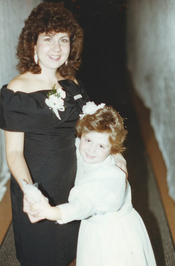 Lisa (Hadden) Donovan, the flower girl, dancing with her mom Karen (Benedetto) Hadden