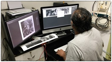 Karthik inspecting an image and setting profiles for the printer.