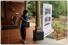 Amer carrying the first frames into the Varija Gallery at DakshinaChitra.