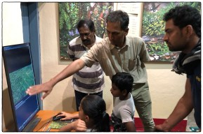 Sridhar helping a few young visitors use the newly installed interactive console in NCF's Anamalais Nature Information Centre.