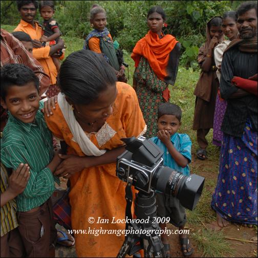 Camera curiosity amongst Paniya tribals at the flooded road near Gurukula.