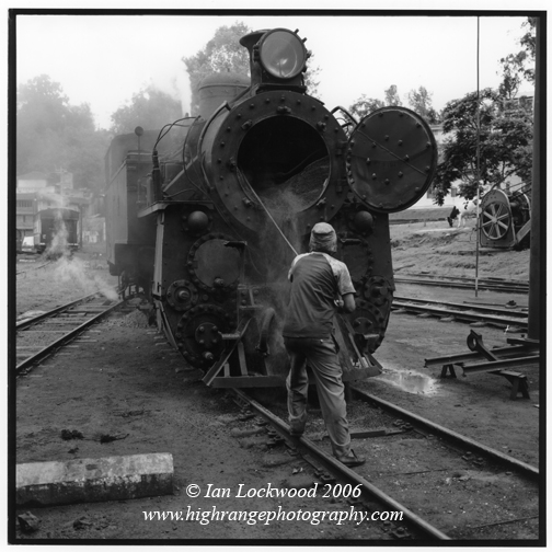 Cleaning a steam locomotive after it made the 3.5 hour ascent from Mettupalayam to Conoor.