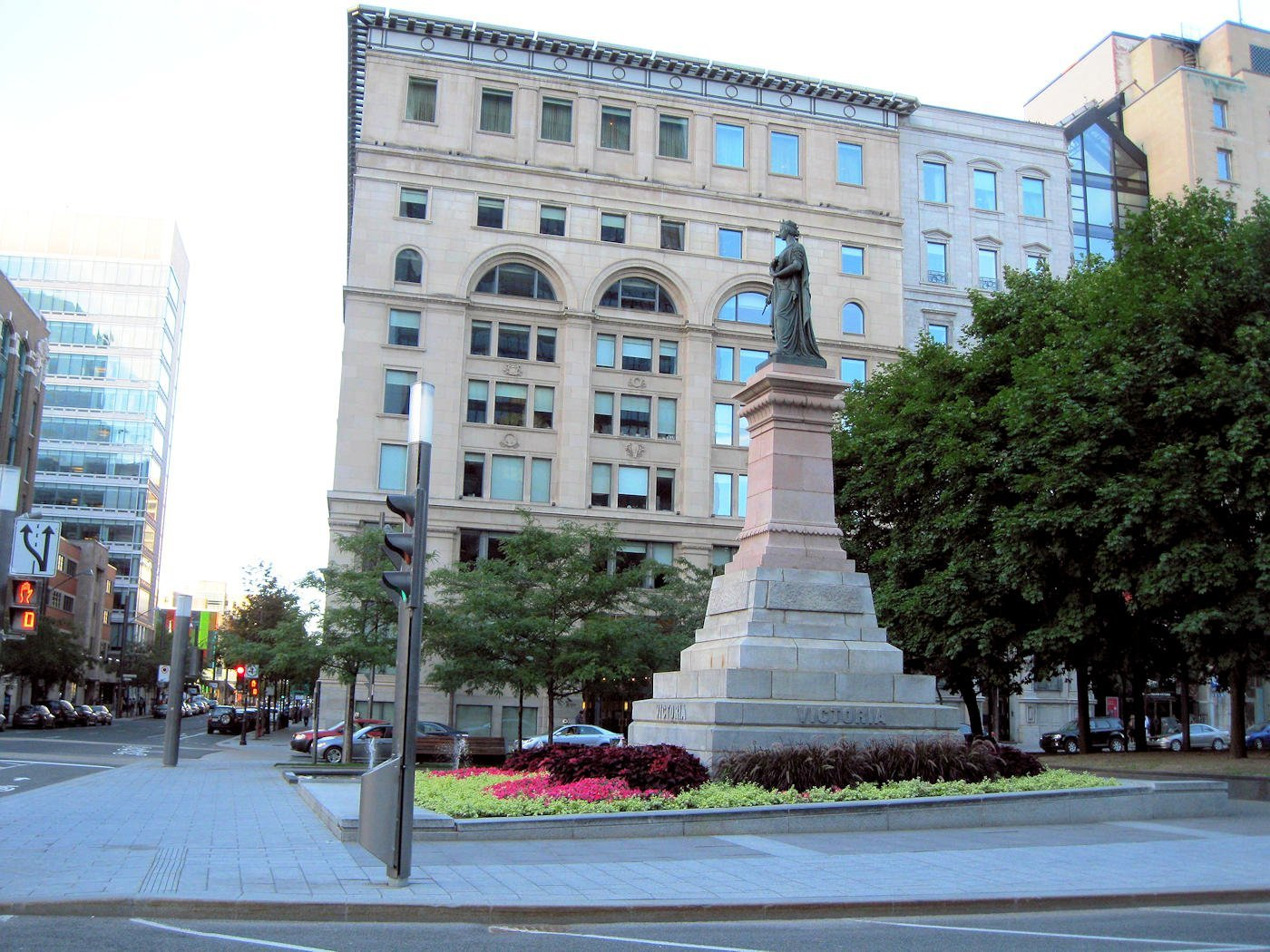 A photo of the statue of the Queen Victoria adorning the Victoria Square is the work of sculptor Marshall Wood (1820–1882), and was unveiled in 1872 by Lord Dufferin, the Governor General of Canada. At the time, the area surrounding Victoria Square was a prestigious neighbourhood