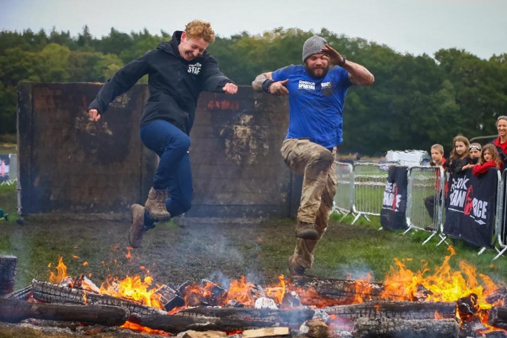 Spartan Race UK Boss Sam Lansdale & UK Race Director Karl Allsop landing the coveting fire jump shot