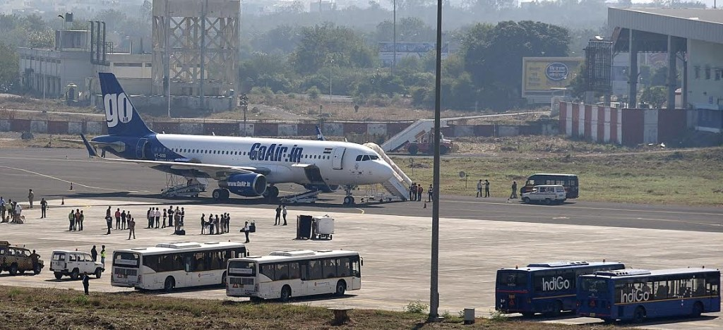 Nagpur: Police checking the Bhubaneswar-Mumbai GoAir flight which made an emergency landing at Nagpur airport following a bomb scare on Jan 23, 2016. (Photo: IANS)