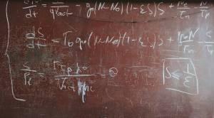 mathematical formula written in chalk on blackboard
