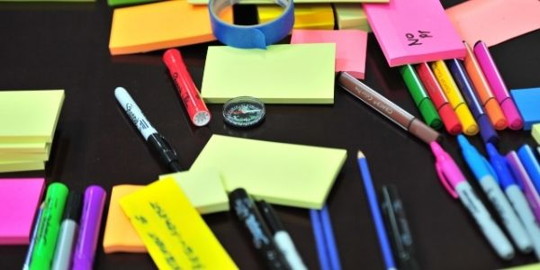 Stationery items including pens, sticky notes, markers, etc. Material needed to study UPSC Mains Syllabus PDF.