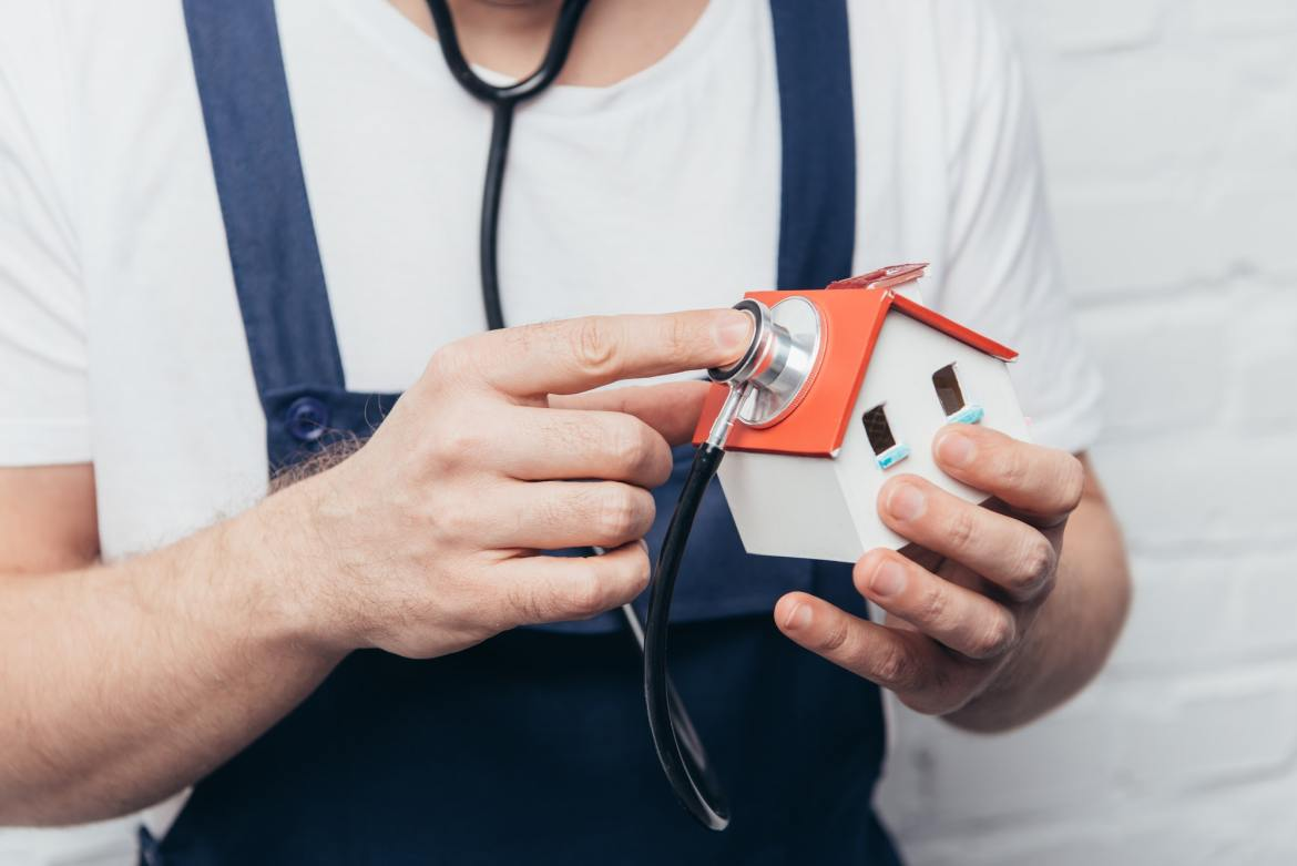 Get An Inspection. Image of a home with a stethoscope.