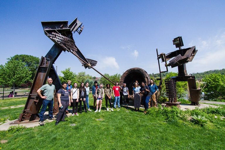 students with art sculptures