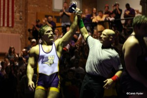 Blaize Cabell gets his hand raised after beatin #7 Ty Walz 5-3