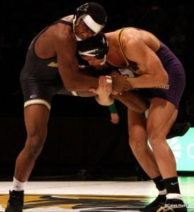 UNI's Basil Minto works a single leg on Missouri's J'den Cox