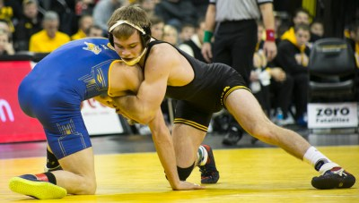 Iowa 149-pounder Brandon Sorensen wrestles South Dakota State's Alex Kocer during their dual meet on Friday, December 4, 2015 in Carver-Hawkeye Arena. (Photo by Rachel Jessen)