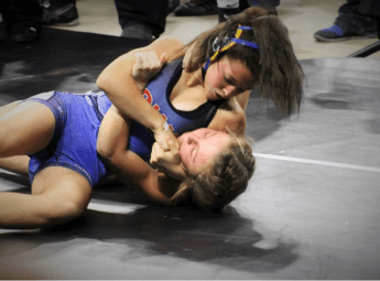 Tateum Park of Davenport North High School working to finish with a headlock. Photo by Jamie Park.