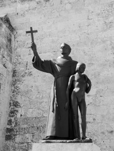Franciscan priest Junipero Serra and Indian boy