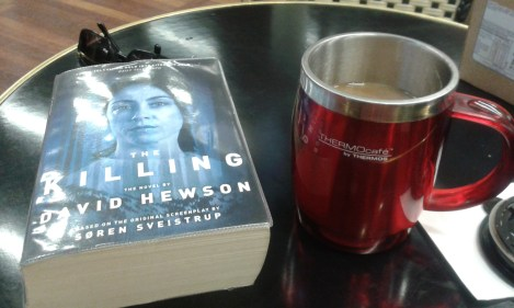 My trusted travel companions: a book and a coffee-to-go!